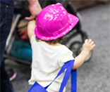 Little girl with pink hard hat